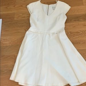White dress with thick material.